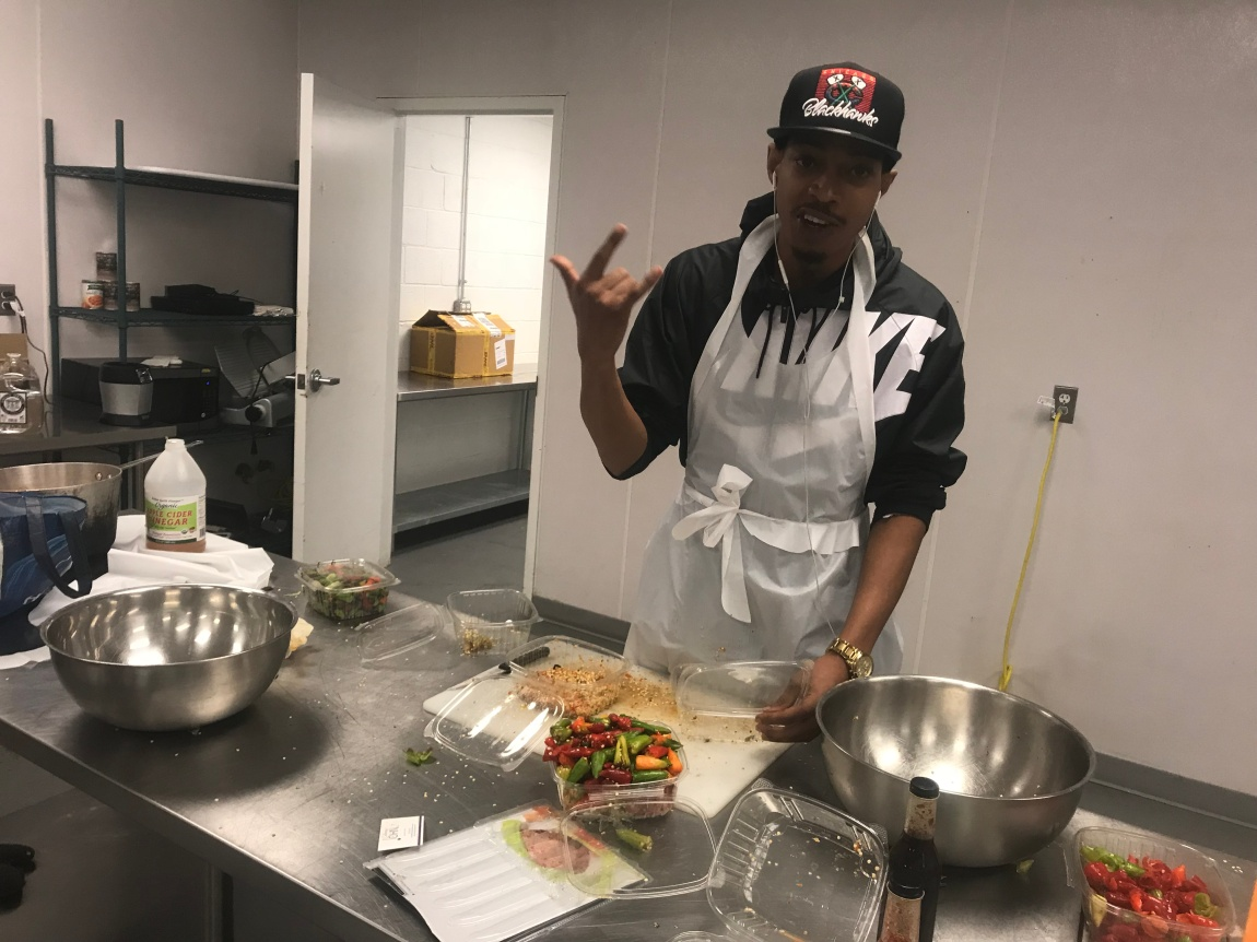 Winford Jones - Chef , a member of the Soilful team help create each batch of sauce.